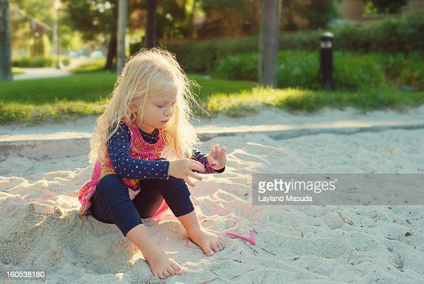 Playing In The Sandbox - Blond Little Girl