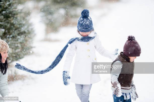 playing in winter - filipino christmas family stock pictures, royalty-free photos & images