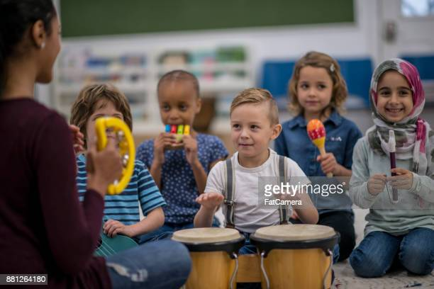 playing instruments together - recorder musical instrument stock photos and pictures