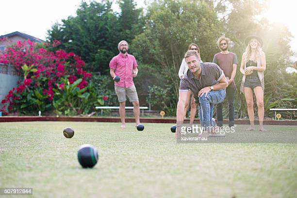 Playing Lawn Bowling