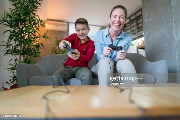playing like pros - family with one child stock pictures, royalty-free photos & images
