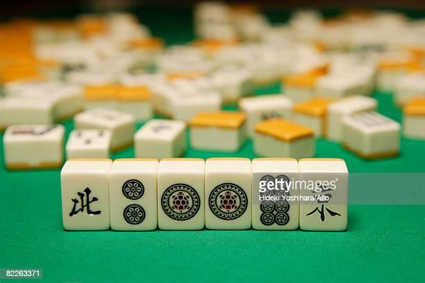 playing mahjong - mahjong stock photos and pictures