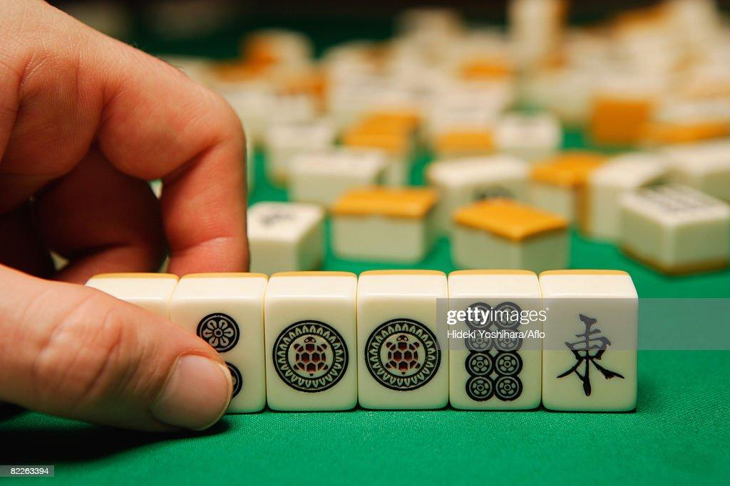 Playing mahjong : Stock Photo