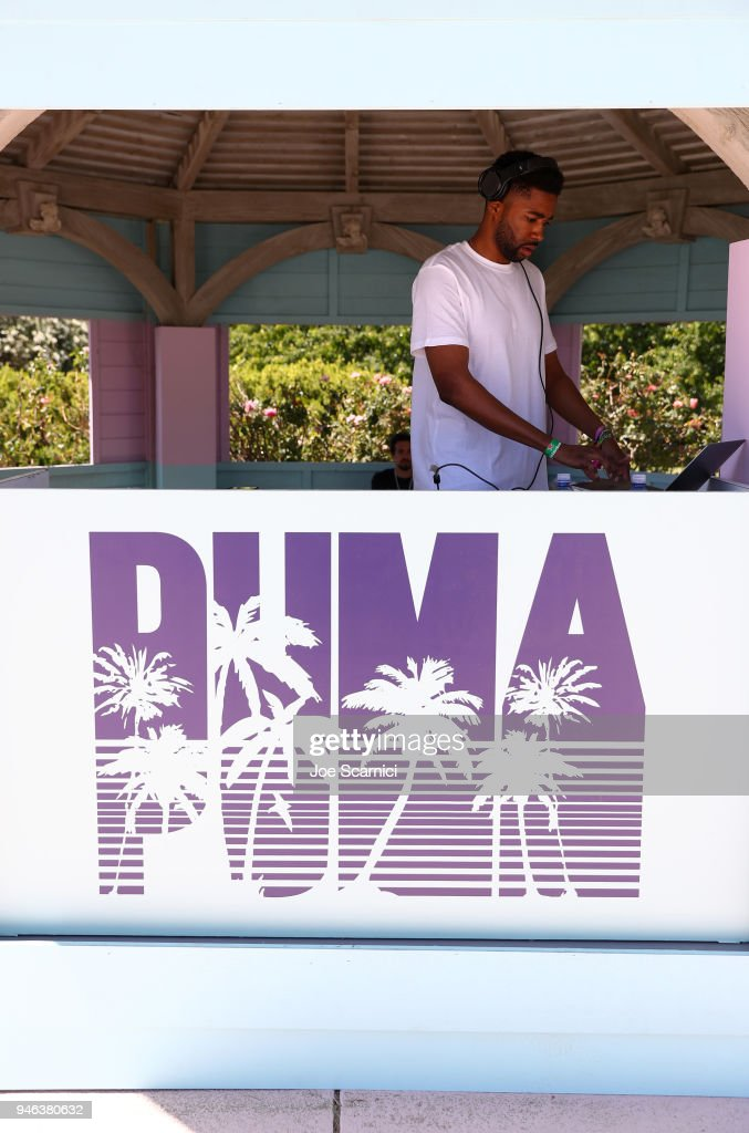 DJ playing music at the FentyXPUMA Drippin event launching the Summer '18 collection at Coachella on April 14, 2018 in Thermal, California.