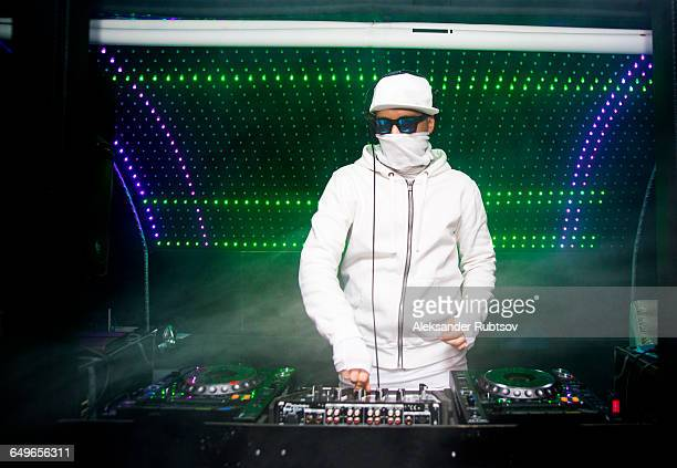 DJ playing music in nightclub