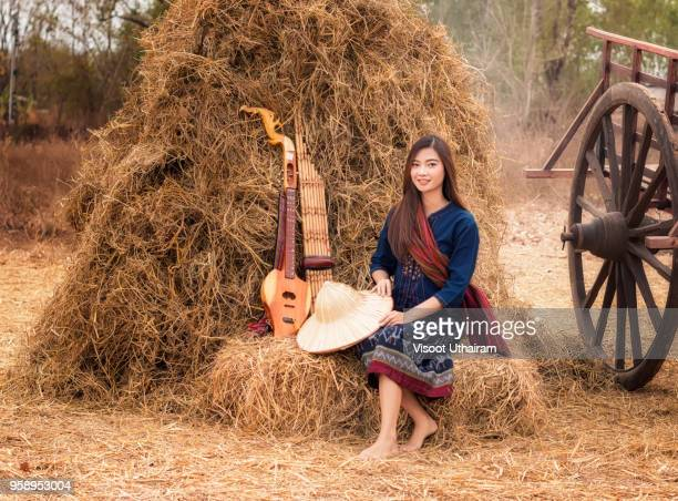 playing music is the relaxation of rural girl in asia. - ラオス ストックフォトと画像