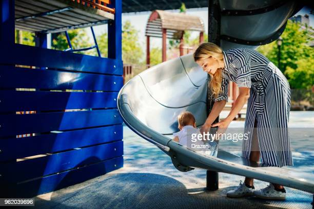 Playing on slides with daughter