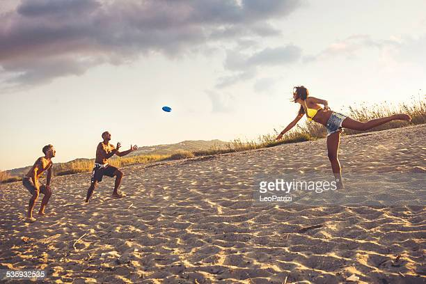 Playing on the beach with a freesbi