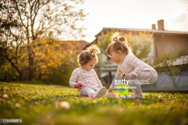 playing on the lawn next to the house during the easter - easter sunrise stock pictures, royalty-free photos & images