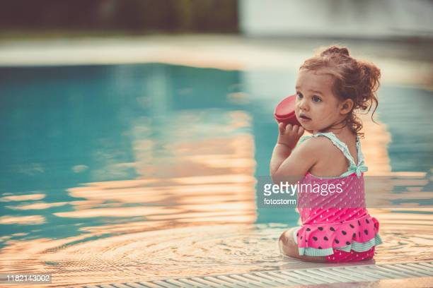 playing on the poolside - 12 23 months stock pictures, royalty-free photos & images