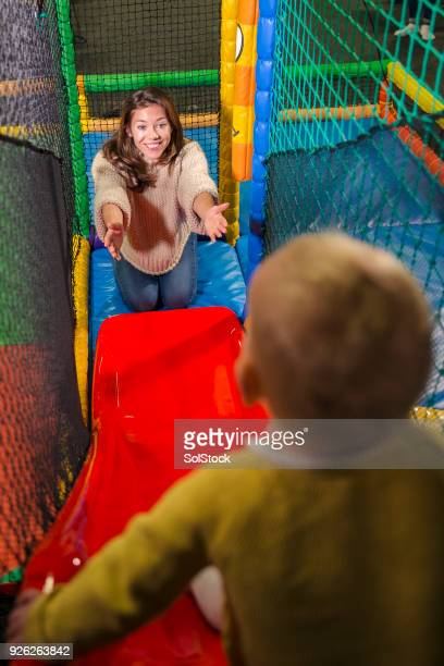 playing on the slide - leap of faith stock photos and pictures