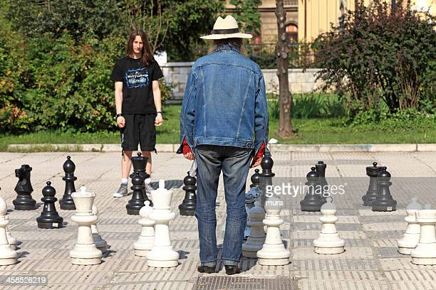 playing outdoor chess - big arse stock pictures, royalty-free photos & images