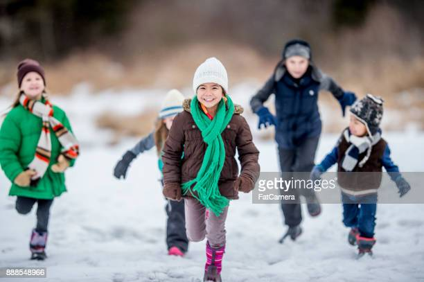 playing outside during winter - playing stock pictures, royalty-free photos & images
