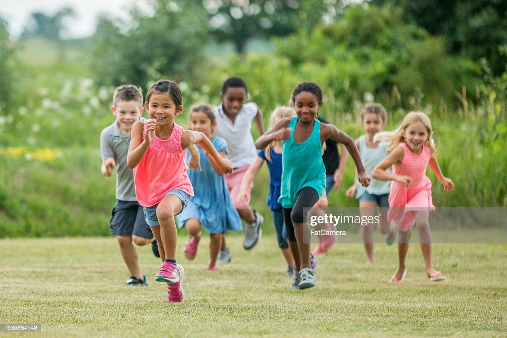 Playing Outside in a Field on a Sunny Day : Stock Photo