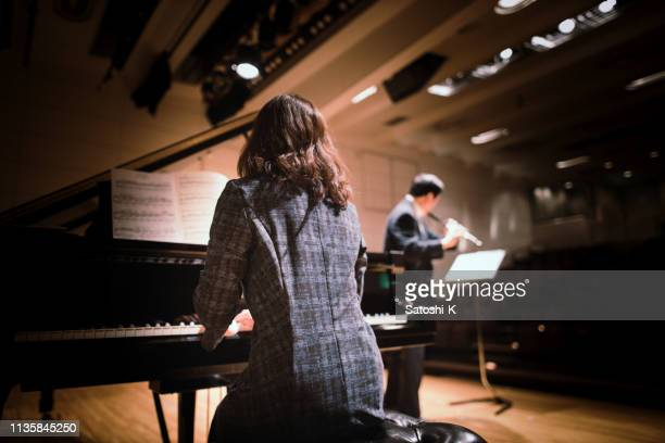playing piano and flute at classical music concert - classical musician stock pictures, royalty-free photos & images
