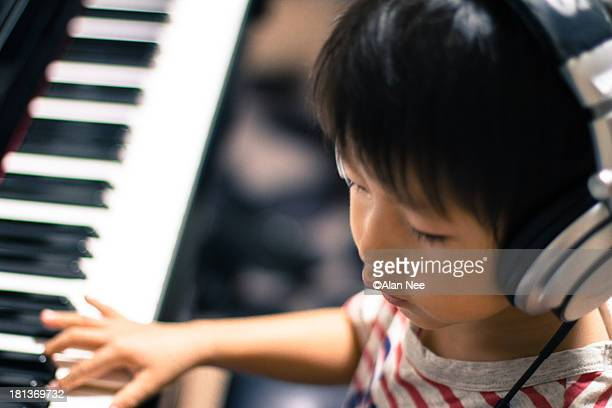 playing piano - nee nee stock pictures, royalty-free photos & images