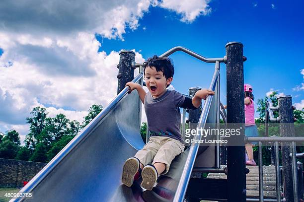 playing - britain playgrounds stock pictures, royalty-free photos & images