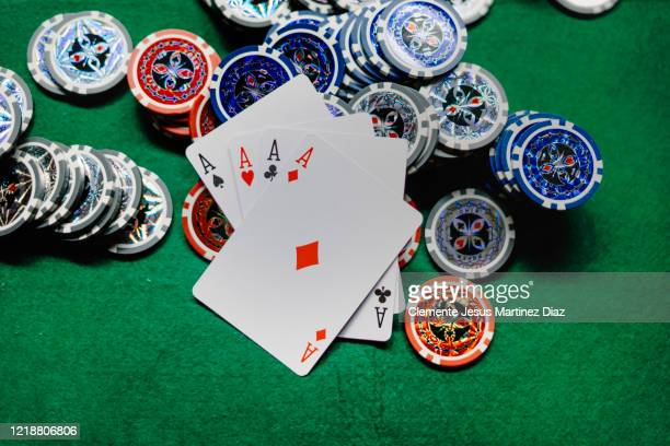 playing poker cards and chips at the poker table - casino stock pictures, royalty-free photos & images