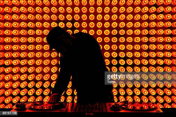a dj playing records at nightclub - equalizer stock pictures, royalty-free photos & images