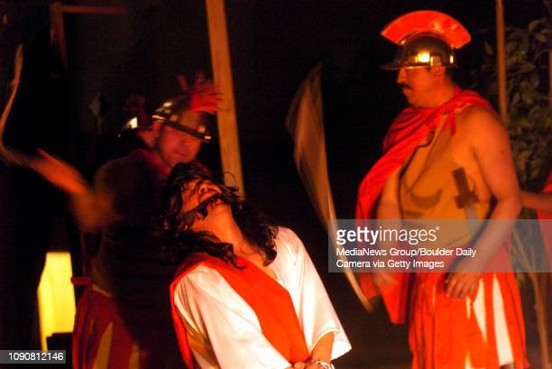 Playing Roman soldiers Enrique Trejillo and Jaime Flores act out whipping Jesus played by Benito Enriquez during a Passion Play at Sacred Heart of...