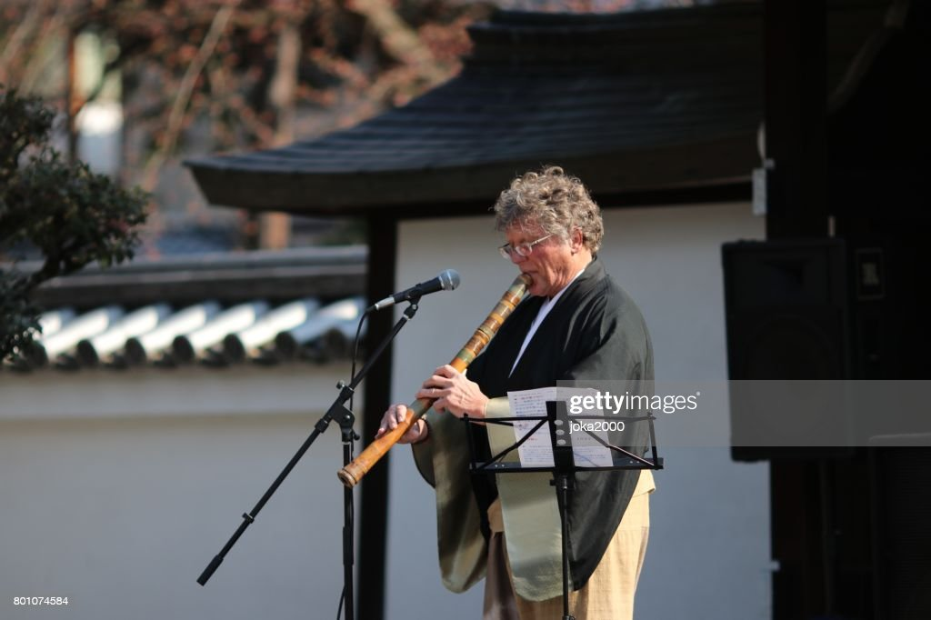 Playing Shakuhachi at stage : Stock Photo