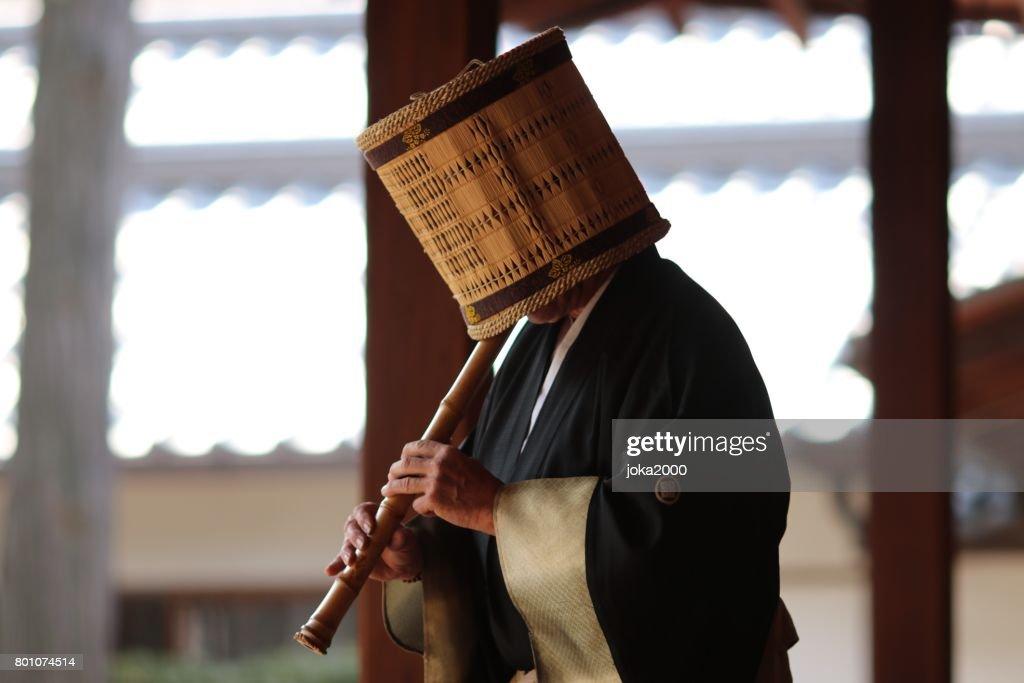 Playing Shakuhachi : Stock Photo
