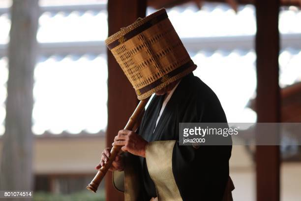 playing shakuhachi - bamboo flute stock photos and pictures