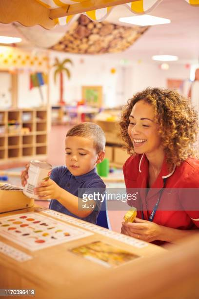 playing shop - teacher stock pictures, royalty-free photos & images