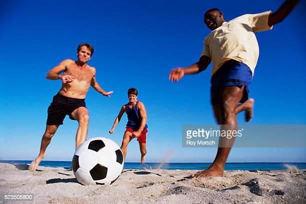 Playing Soccer at Beach
