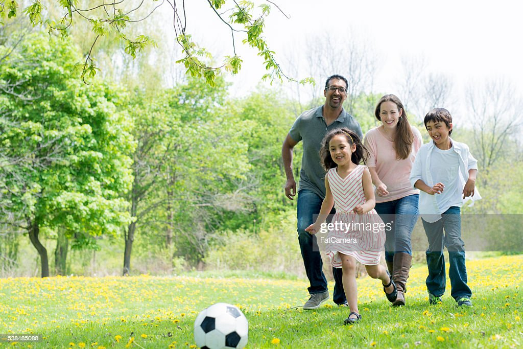 Playing Soccer at the Park : Stock Photo