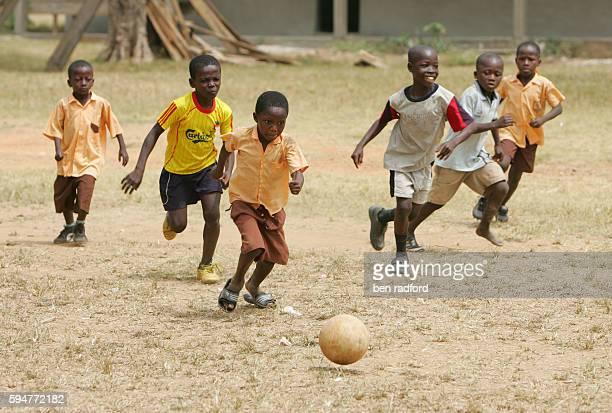 Playing soccer during play time at the No.1 School, Enkawaba Village, Ashanti, Ghana, West Africa. | Location: Ashanti, Ghana.