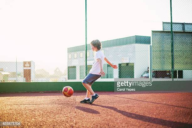 playing soccer - kicking stock pictures, royalty-free photos & images