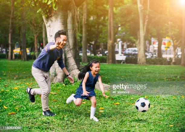 playing soccer with dad taipei - sporting term stock pictures, royalty-free photos & images