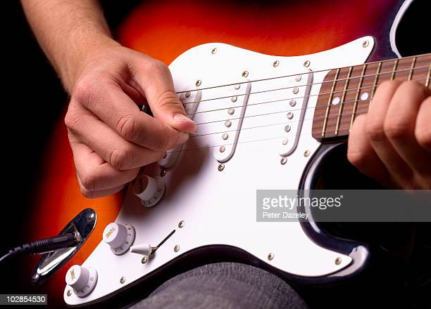 playing solid electric guitar close up - electric guitar stock pictures, royalty-free photos & images