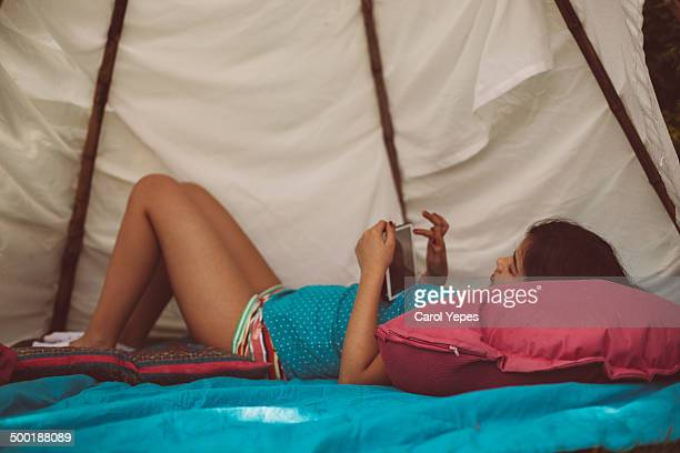 playing tablet in the tepee - hot pants stock photos and pictures