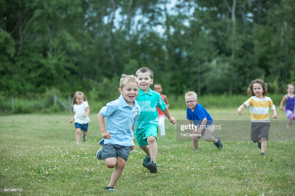 Playing Tag at the Park : Stock Photo