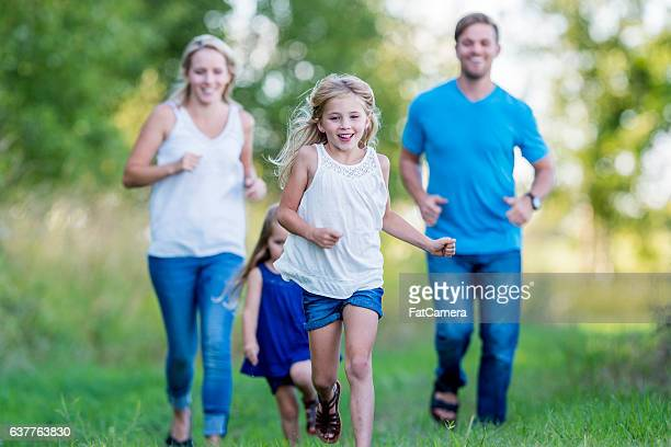playing tag at the park - kids playing tag stock photos and pictures