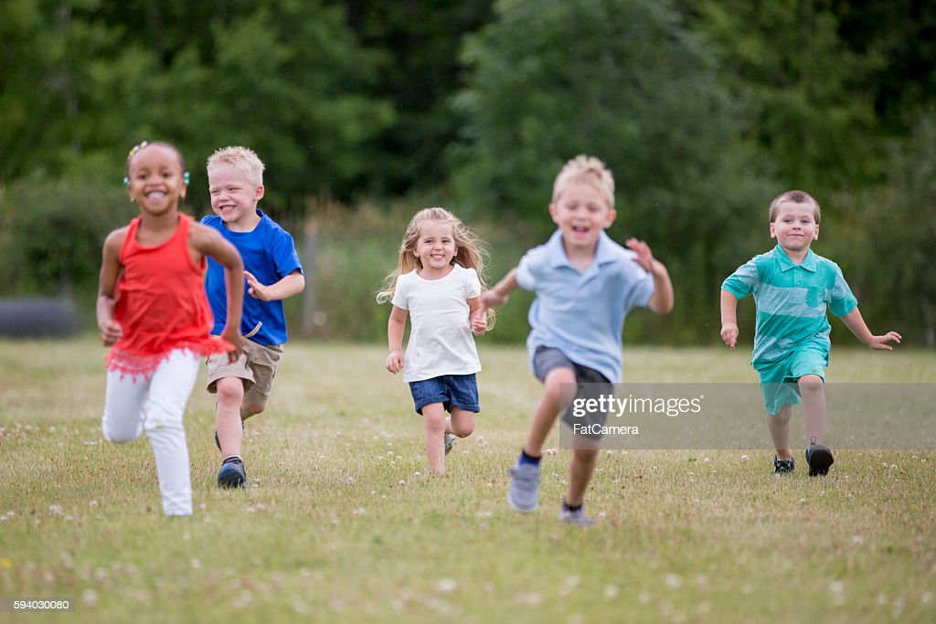Playing Tag During Recess : Stock Photo