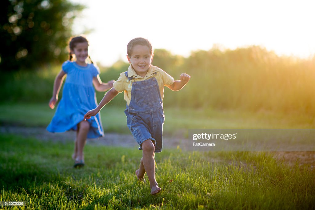 Playing Tag in the Front Yard : Stock Photo