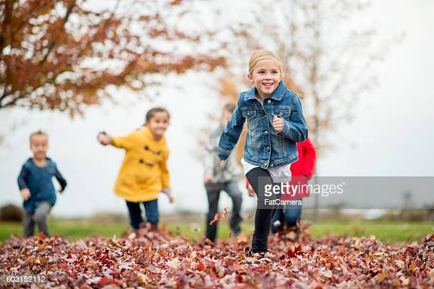 playing tag on an autumn day - kids playing tag ストックフォトと画像