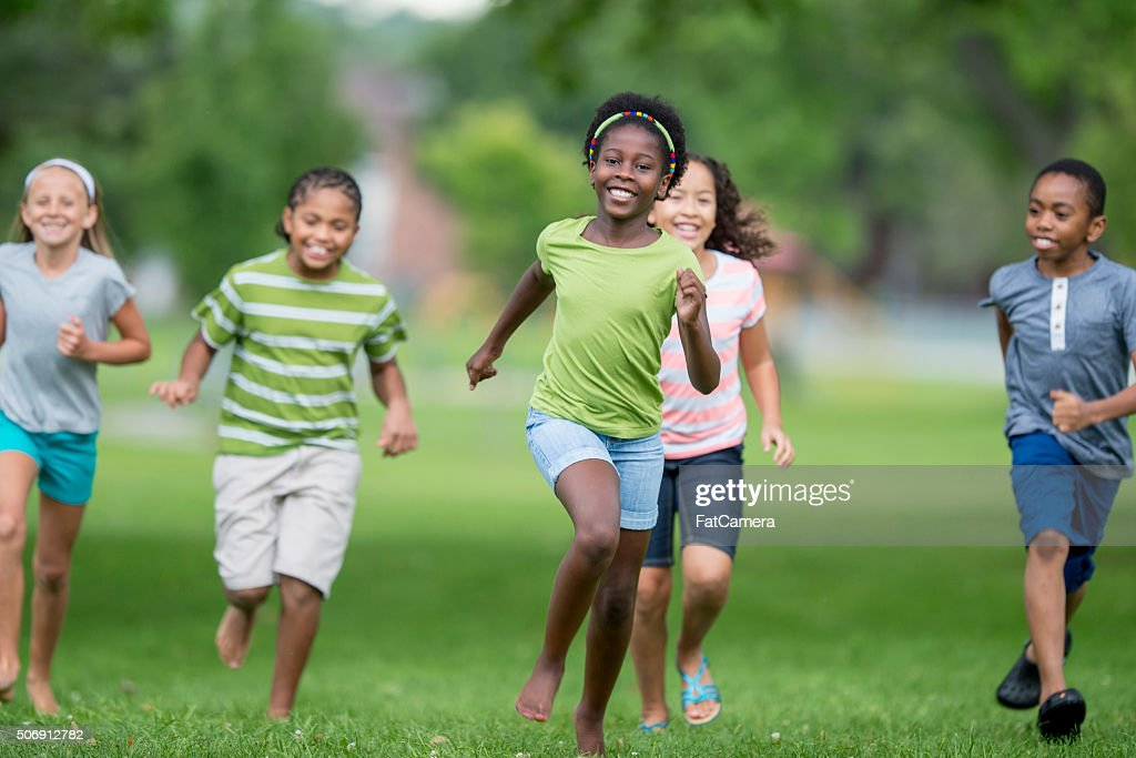 Playing Tag Outside : Stock Photo