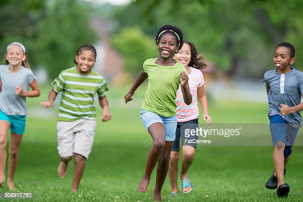 playing tag outside - kids playing tag stock photos and pictures
