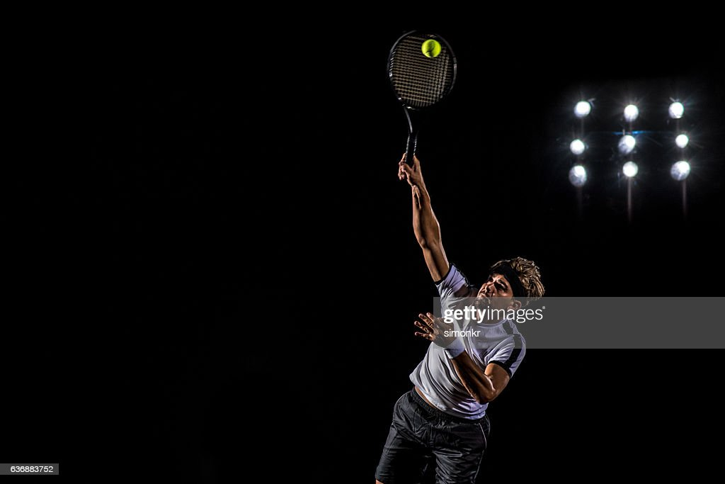 Playing tennis at court : Stock Photo