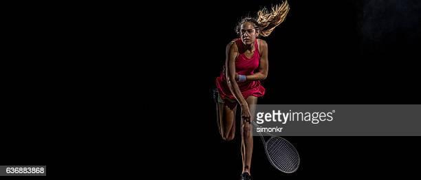 Playing tennis at court
