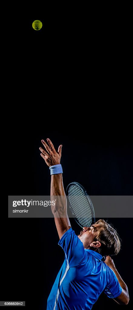 Playing tennis at court : Foto stock