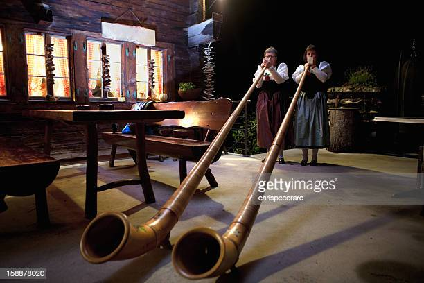 playing the alpenhorns - swiss culture stock pictures, royalty-free photos & images