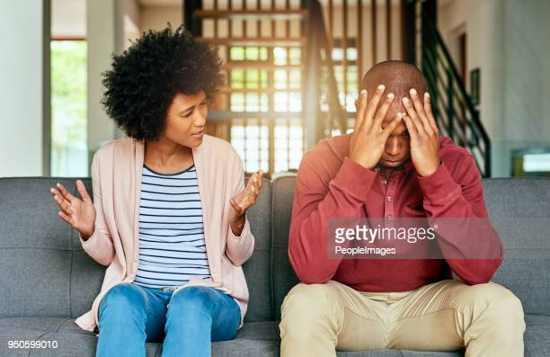 playing the blame game - couple arguing stock photos and pictures