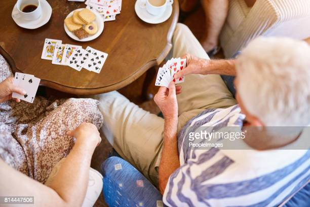 playing the cards they're dealt - organised group stock pictures, royalty-free photos & images