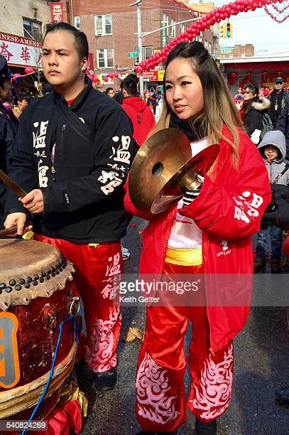 Playing the cymbals and Chinese drum as part of the Lion Dragon dance routine at the Chinese New Years Festival Parade in the Chinatown section of...