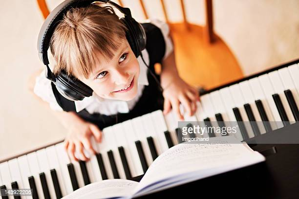 playing the digital piano - keyboard player stock photos and pictures